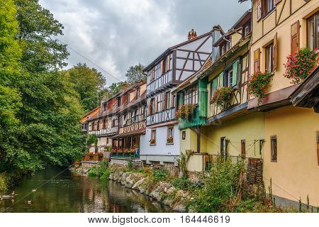 Historic houses on the embankment of Weiss river in Kaysersberg Alsace France