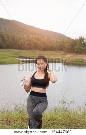 Sport And Health Lifestyle - Young Woman With Bottle Of Drinking Water After Workout Exercising In P