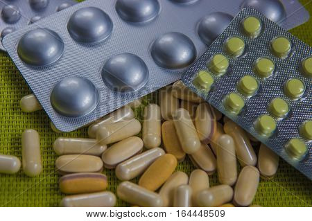 Drugs capsule and pill medicine. Assorted pills on the table