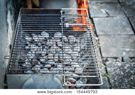 Hot Red Coal Under Barbecue Grill.