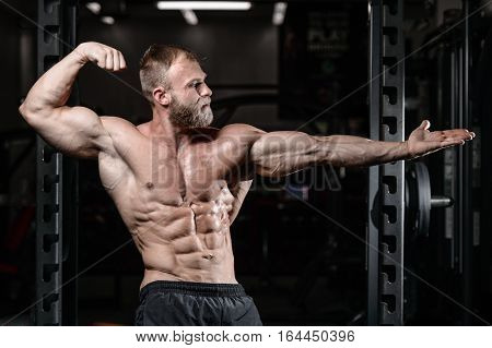 Brutal Muscular Man With Beard Unshaven Fitness Model Healthcare Lifestyle.