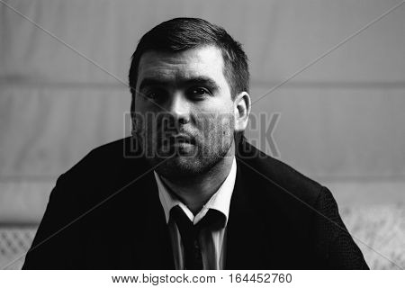 serious man close-up portrait. Black and white photography