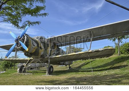 The retired Antonov An-2 military aircraft camouflaged