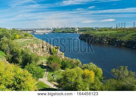 View on Hydroelectric Station dam (largest hydroelectric power station on the Dnieper River) and industrial area of Zaporizhia city Ukraine.