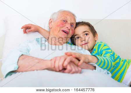 Grandmother And Grandson In Bed