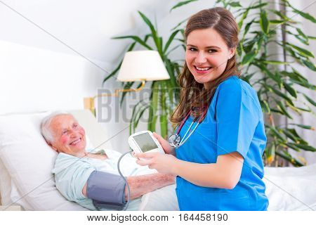 Loving Caregiver Measuring Blood Pressure