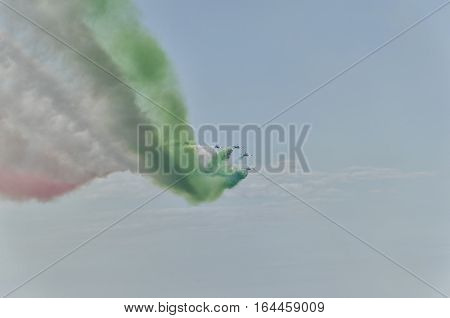 The trail of colored smoke draw the Italian flag