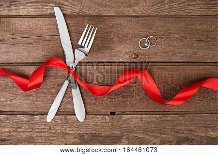 Table decoration Valentine's Day, table set with a ribbon. Image of dinner on Valentines day. Top view. Still life