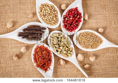 The colorful of herb spices on sack background.