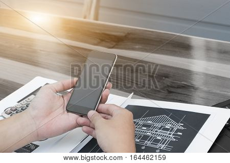 business technology conceptBusiness people hands use smart phone and laptop for business analyst project on table.selective focus.