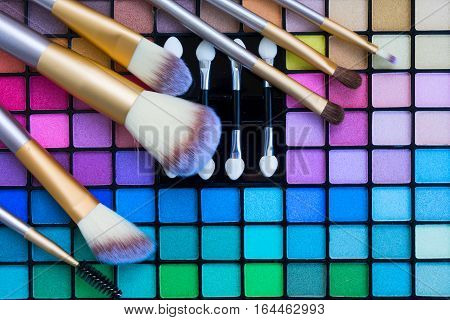 Set of Make up Brushes and colorful eye-shadows palette