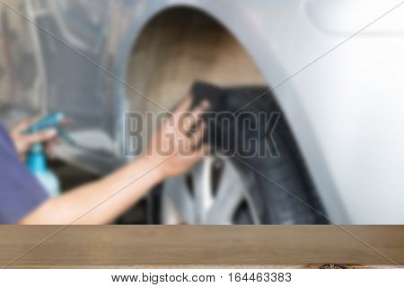 Cleaning Car Wheel, Mechanic Hands Giving A Care On A Tire Rim By Cleaning The Dust With Cloth (blur