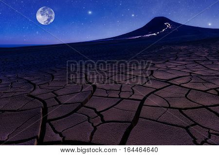 Full moon in night starry sky and volcano