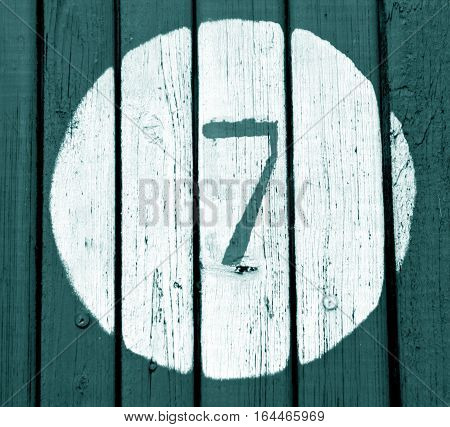 Number Seven On Cyan Toned Wooden Wall