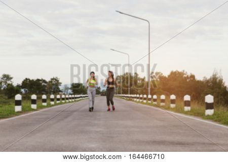 Young Woman Running At The Park (blur Image)