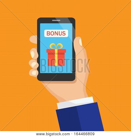 Hand holding smartphone with gift box on the screen. Concept of gift. Hand with phone with present box icon and Bonus button. Flat design, vector illustration.