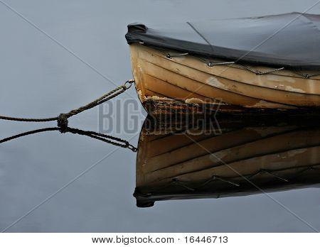 Old rowboat moored in a peaceful bay - Strahan, Tasmania