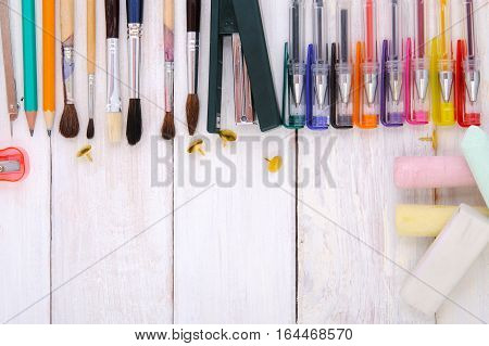 Various Office Supplies On A White Wooden Background.