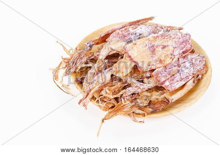 Dried squids in wooden dish isolated on white background.