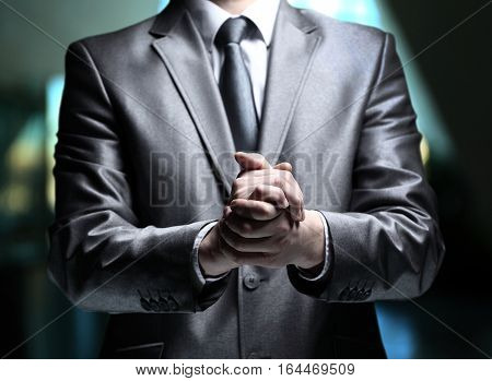 Hands steady business man on a dark background