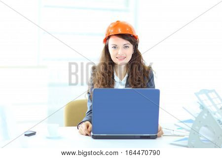 Beautiful businesswoman engineer working on a laptop in the office.