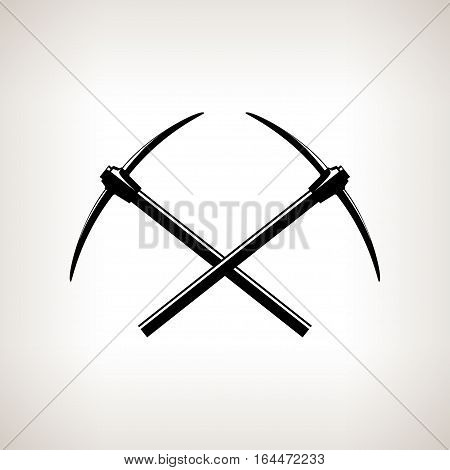Silhouettes of two crossed pickaxes on a light background ,hand tool with a hard head attached perpendicular to the handle, black and white illustration