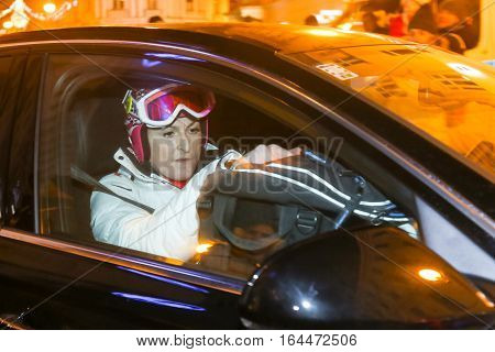 ZAGREB, CROATIA - JANUARY 4th, 2017 : Ski race of overall winners of the FIS World Cup on the ski slope in Bakaceva street, on the road from the cathedral to the main square. Janica Kostelic leaving ski race in the sponsor car.