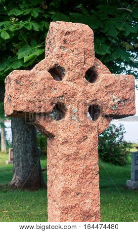 Celtic cross in a graveyard in prince edward island