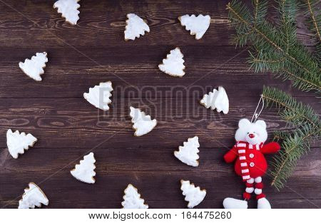 New Year card. Christmas Ginger and Honey colorful cookies with fir tree branches. Merry Christmas and Happy New Year winter greeting card background. Old rustic wood texture  pine tree branches. Christmas baking concept - some cookies, fir tree brunches