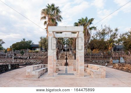 Decorative arch and bench in National Park in Capernaum (Cafarnaum).