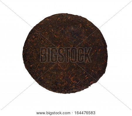 Raw sheng (shu) puerh tea cake isolated on white background