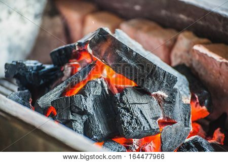 Close-up of a burning charcoal on the stove
