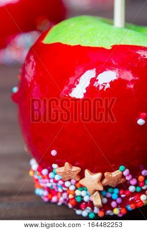 candy apples with confectionery on wooden table. macro