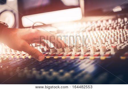Audio Mixer Sound Adjusting Closeup Photo. Professional Sound Mixer Operator.
