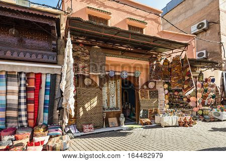Marrakesh Morocco - December 8 2016: Islamic-style textiles and souvenirs on the famous souks in medina of Marrakesh Morocco.