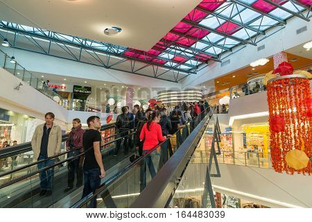 Moscow, Russia - October 01.2016. People on the escalator in the shopping and entertainment center Gagarin