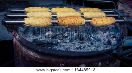 Chimney cakes cooking over the coals in argentina