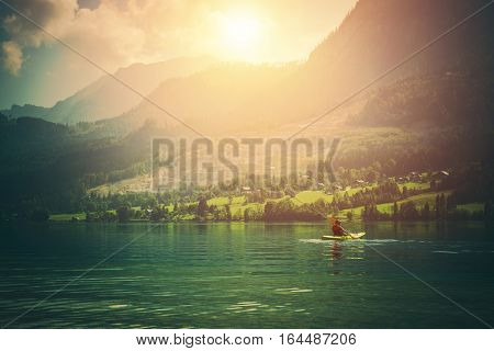 Kayak Tour on the Scenic Mountain Lake. Recreational Kayaking. Caucasian Kayaker.