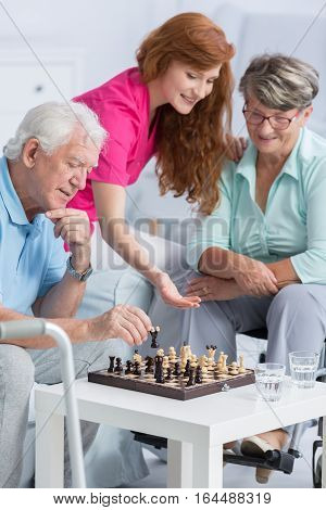 Couple Playing Chess In Nursing Home
