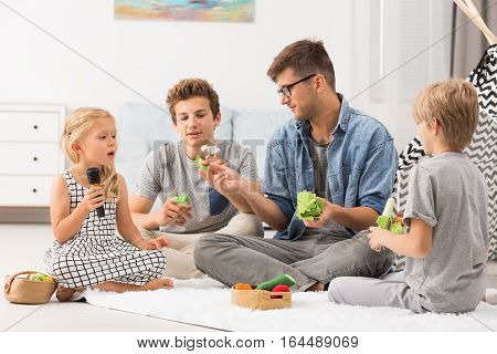 Dad And Children Playing With Finger Puppets