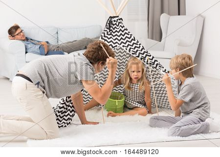 Children Playing In Living Room