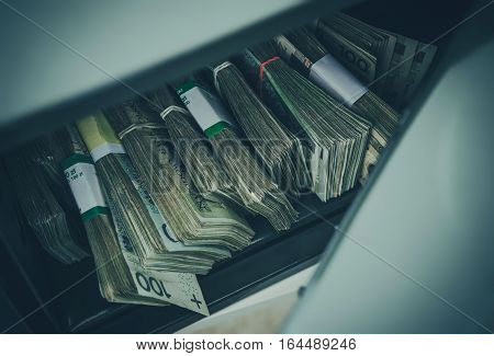 Pile of Polish Zloty in Residential Style Safe Box. Polish Zloty Banknotes Cash Money Savings.