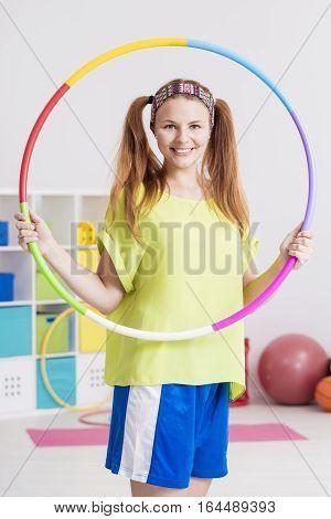 Sportswoman With Hula Hoop