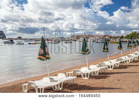 Budva, MONTENEGRO - SEPTEMBER 19, 2016:sunbeds and umbrellas are on the beach in Budva, Montenegro.