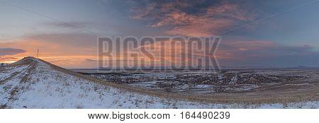 Panorama of winter sunset over the Siberian village