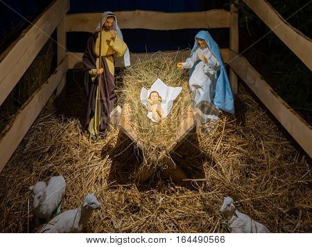 Christmas Manger simple scene with figurines including Holy Family - Jesus Mary Joseph and sheep