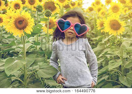 child wear Heart sunglasses with sunflower, happy, child
