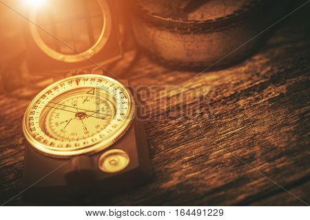 Vintage Journey Compass Concept Photo. Aged Compass on the Old Wooden Table.
