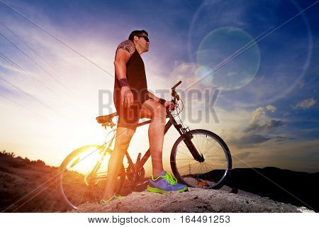 Sport and healthy life.Mountain bike and sunset.Extreme sports.Mountain bicycle and man.Life style outdoor extreme sport