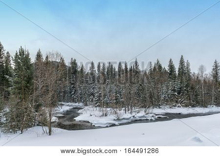 Winter landscape with river in Khakasia in Siberia
